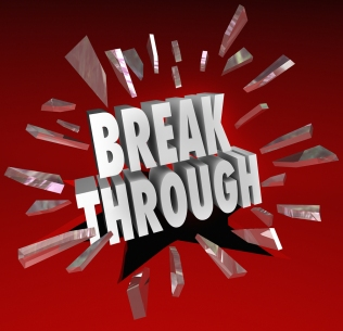 The word Breakthrough breaking through glass to symbolize discov